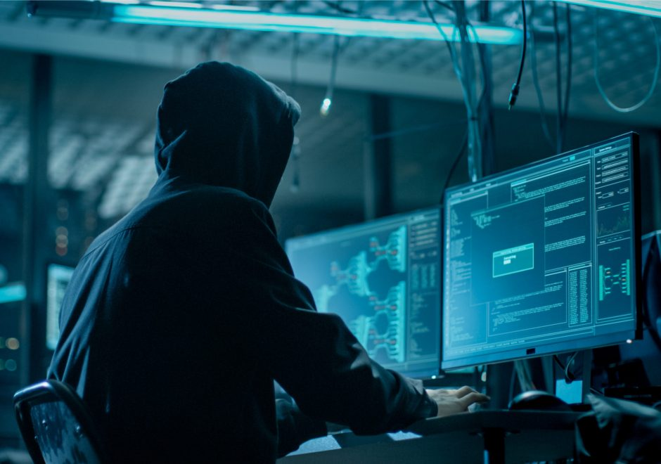 hacker wearing hood